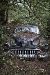 Forgotten (Betty Cowart) Tags: oldcarcity buried pineneedle junkyard abandoned neglected forgotten car auto vintage old chrome grille rust shiny forest vine georgia