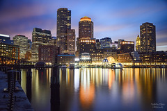 USA | Boston Harbor Sunset (Nicholas Olesen Photography) Tags: usa boston skyline sunset blue hour harbor water reflection buildings architecture horizontal outdoors nikon d7100 travel dusk sky clouds lights city cityscape downtown