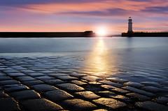 Flash of Sunshine (zdenisaba) Tags: sunset horizont sunshine flash port lighthouse light water sea scotland surface sky clouds longexposure cobblestone holiday landscape land