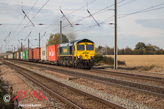 Cambridgeshire Containers...but not as we know it, Jim (CS:BG Photography) Tags: abbotsripton footcrossing ecml eastcoastmainline class66 shed freightliner 66597 viridor containertrain intermodal