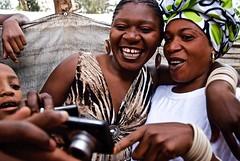 Photographer and Refugee Carine Asha Sharing A Portrait With Her Friend (camera_rwanda) Tags: raw africa refugee photographyinafrica refugeephotographer kizibacamp unhcr africahumanitarianaction carineasha rwanda congolese refugeecamplife refugeeart teachingphotography friendship nikon nikoncoolpix womenwithcameras empowerment refugeeempowerment