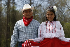 Christian Canales, left, and Dayana Hervert Gonzalez, 11, right, pose for a portrait in Robinson Park. Christian Canales and Gonzales have been dancing in Abila's group since it started.