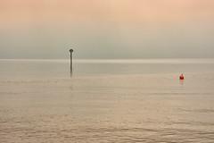 Morning fog at the lake (flowerikka) Tags: atmosphere bodensee boje earlymorning fog lake mist see silence sky sun ufer water
