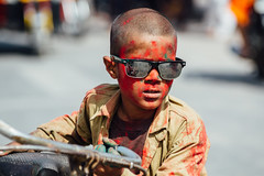 Holi: Gulal-Covered Boy in Sunglasses (AdamCohn) Tags: adam cohn uttar pradesh abeer gulalगुलालabeerअबीर india mathura vrindavan boy color gulal holi sunglasses wwwadamcohncom अबीर गुलाल adamcohn uttarpradesh