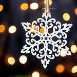 Beautiful snowflake on the background of Golden bokeh thumbnail