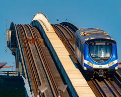 A TransLink Canada Line Train Departs Sea Island in the Evening Light... (AvgeekJoe) Tags: britishcolumbia canada canadaline d7500 dslr hyundairotememu importedkeywordtags lightrail nikon nikond7500 skytrain train translink vancouver masstransit masstransportation publictransit publictransportation rail transit urbanrail sigma150600mmf5063 150600mmf5063 15006000mmf5063 150600mmf563dgoshsm|c sigma telephotolens lens