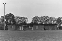 sports ground (Lennart Arendes) Tags: tree gras field sports ground building kodak trix 400 analog 35mm kb bw black white schwarz weis 50mm rodinal