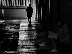 ... now he is gone (heinzkren) Tags: schwarzweis blackandwhite bw sw monochrome street streetphotography candid panasonic lumix silhouette woman wien vienna blurred dark mystery magical man