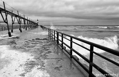 Waves on the Pier (mswan777) Tags: ansel cloud mobile iphone iphoneography apple white black horizon sky monochrome stjoseph lakemichigan lighthouse railing pier weather wind nature outdoor coast shore seascape crash spray wet wave water