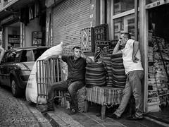 Street 578 (`ARroWCoLT) Tags: tahtakale streetphotography sokak people blackwhite bw art insan human arrowcolt monochrome bnwdemand bnwpeople bnw bnwstreet ishootpeople blackandwhite portrait streetportrait canon200d turkey türkiye istanbul eminönü shopkeeper chat sohbet shopfronf rag halı kilim 24mmstm carpetshop carpet
