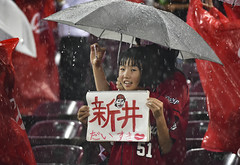 A GIRL IN THE RAIN (Sign-Z) Tags: nikon d4s 70200mmf28gvr hiroshima carp baseball girl red 広島 広島東洋カープ 雨 rain
