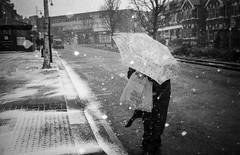 snowy moment (jrockar) Tags: street streetphoto streetphotography candid decisive moment instant london southwoodford analogue film photography agfa apx400 rodinal xa3 olympus flash flashphotography weather snow winter wind umbrella jrockar janrockar ordinarymadness ordinary madness filmisnotdead dead storm