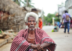 India through the eyes-Old Indian man sitting on the street (Nithi clicks) Tags: india indian color beard bruised eyes grey hair kerala man old pleading rough sad skin tired tourism travel turban weathered
