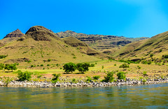 Hells Canyon Shoreline (http://fineartamerica.com/profiles/robert-bales.ht) Tags: aupload fahellscanyon fb facebook forupload haybales hellscanyontrip hillcanyon idaho people photo photouploads places projects states nature canyon floating recreation river wilderness area remote mountain america usa wild white hell oregon green range vacation scene outdoors scenic hells hiking tourism water salmon blue snake desert eastern fishing fly outdoor riggins rock rugged nez trout beauty steelhead conservation clouds devils tourist gorge mountains snakeriver hellscanyon robertbales boat jetboat rapids mixedmedia rafts shoreline house