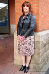 Do you like the Holly Willoughby must haves (janegeetgirl2) Tags: transvestite crossdresser crossdressing tgirl tv ts heels nylons glamour ankle boots summer shirt dress jane gee outside promenade brighton leopard biker jacket black