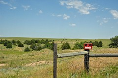 062909-031F (kzzzkc) Tags: nikon d200 usa nebraska ogallala rural prairie wire fence nohunting sign grass trees day pdpartlycloudy barbedwire