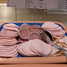 Wurstspezialitäten Aufschnitt an einem Buffet mit Zange zum bedienen - Kräterbraten, Salami und Kochschinken