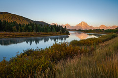Golden Hour Glow (Bob C Images) Tags: sunrise goldenhour glow mountains trees water lake reflection nationalpark grandtetons