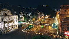 Busy Night Downtown (SkylinePat) Tags: citiesskylines cities skyline skylines city town computer game screenshot castle windmill oldtown bus station tourists zebra crossing road workshop assets