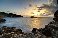 Sunrise, Cala Ferrera, Cala Dor, Majorca (vincocamm) Tags: majorca calador seascape volcanic rock sea water sunrise orange blue nikon d5500 longexposure sunburst sunny clouds sky morning spain bal balearics coves