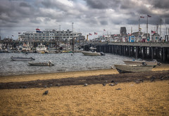 Provincetown Harbor and Pier with Cruise Ship (donnieking1811) Tags: massachusetts provincetown provincetownharbor pier cruiseship beach water boats buildings flags americanflags outdoors sky clouds sand hdr canon 60d lightroom photomatixpro