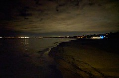 View of seashore and distant lights at night. (elnina999) Tags: reflection nightclouds seashore sopot poland beach night rest panorama citylights clouds touristy attraction pixelphone mobilephonephotography darkness seawater landscape outdoors