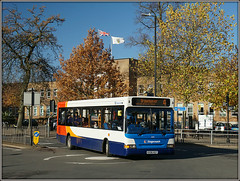 Stagecoach 35185 (Jason 87030) Tags: paint fresh repaint new revised clean livery dennis dart slf pointer 35185 kx56kgy 4 brownsover evreaux way road november stagecoach midlands rugby town service route red white blue orange bus fleet wheels transport trees autumn flags