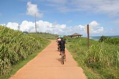 Lori, Michele, and Rachel riding (kahunapulej) Tags: rachel lori johnson michele tonnemaker bicycle riding path coast kauai beach family fun