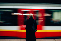 The epic cycle and lyrical poem of getting home on time. (ewitsoe) Tags: autumn city cityscape ewitsoe fall street warszawa erikwitsoe erikwitsoecom urban warsaw motion train metro moving moment blur speed lady waiting woman student goinghome travel purse bag coat life time traveler nikon 35mm urbanlandscape