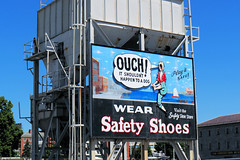 OUCH! (Eclectic Jack) Tags: boston massachusetts ma ouch sign dog wear safety shoes shoe feet blue sky play safe uss constitution museum olympus em1 camera photo photograph store visit old american history americana