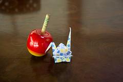 Paper Crane and Top (Eridanus 21) Tags: paper crane topツルとコマ top origami おりがみ 折り鶴 ツル 折り紙 コマ origamiphoto 玩具コマ papercrane 玩具