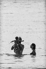 tenderness (*BegoñaCL) Tags: baby sea mediterráneo summer man woman trio couple water begoñacl candid backlight