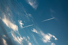 Airplane Trail (katyearley) Tags: airplane blue clouds white fluffy lines dark sunset summer texas canon rebel t6