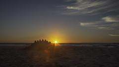 Yesterday's Sand Castle and the Risng Sun (jessicalowell20) Tags: atlanticocean beach blue coast coastal dawn flare longbeachisland newjersey northamerica ocean orange sand sandcastle september summer tan water waves white