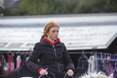 Young horsewoman (Frank Fullard) Tags: frankfullard fullard candid street portrait horse horsewoman celt celtic irish ireland galway red redhead ginger freckles beauty ballinasloe heritage whip jockey ride rider pony ponytail tail