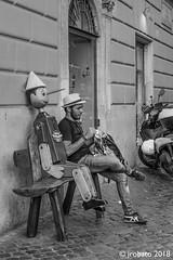 Sitting With Pinocchio (orgazmo) Tags: streetphotography monochrome blackwhite rome roma italy italia people olympus omd em1mk2 micro43s m43s panasonic leica leicadgvarioelmarit818mmf284asph