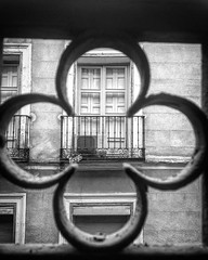 La Puerta (El Cheech) Tags: spanish european window door fence vacation eurotrip2018 balcony elcheech photography blackandwhitephotography blackandwhite españa eurotrip europe spain madrid
