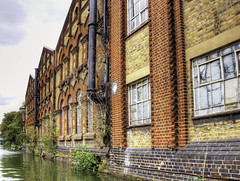 Old factories along the Oxford Canal (Digidoc2) Tags: warehouses factories buildings canal old disused shrubs water sky oxfordcanal urban waterways architecture alternativeviews