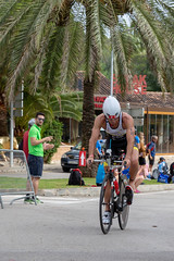 The Triathlet Francesc Artigues Ramis at the dismount zone at the Challenge Triathlon in Peguera 2018 (verchmarco) Tags: people menschen competition wettbewerb road strase recreation erholung wheel rad exercise übung man mann race rennen outdoors drausen fun spas street fitness sport leisure freizeit woman frau athlete athlet vehicle fahrzeug adult erwachsene summer sommer travel reise catwa football fish japan second avatar dof colorful vacation foliage