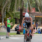 The Triathlet Francesc Artigues Ramis at the dismount zone at the Challenge Triathlon in Peguera 2018 thumbnail