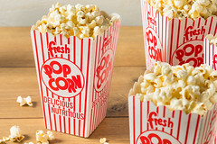Classic Buttery Movie Theater Popcorn (brent.hofacker) Tags: background bag box bucket cardboard carton cinema classic color container corn crunchy cut delicious entertainment fastfood fluffy food fresh full jumbo large movie moviepopcorn movietheaterpopcorn pack pop popcorn red refreshment salty snack striped stripes sweet takeaway takeout tasty unhealthy