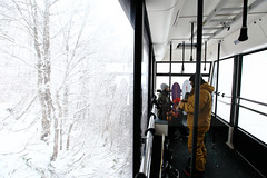 Insulated (Elios.k) Tags: horizontal indoors people two twopersons man woman couple snowboard snowboarder apparel warmclothes equipment wintersport sport activity cablecar interior ropeway sanrokuline zaoropeway cabin glass window forest outside snow trees bare baretrees nature winter cold freezing colour color travel travelling vacation december 2017 canon 5dmkii camera photography zao mountainzao mtzao zaoonsen zaōonsen mountzao skiresort yamagataprefecture tōhokuregion tohoku honsu asia japan