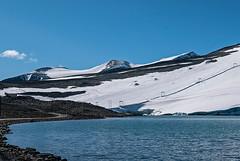 Across Juvvatnet towards Mt Galdhøpiggen (Lars Ørstavik) Tags: galdhøpiggen vetljuvbreen glacier juvvatnet lake outdoors landscape sky mountainside peak skilift