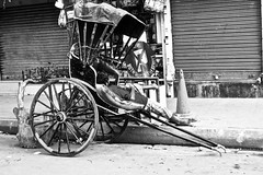 Rickshawman (Synghan) Tags: rickshaw rickshawman manpower passive sleeping resting relaxation comfort refreshment refresh sideview blackwhite monochrome india kolkata calcutta indian highangle photography horizontal outdoor colourimage fragility freshness nopeople foregroundfocus adjustment interesting awe wonder fulllength lifestyle asia asian massive concept travel destination attraction street view road avenue wheel canon eos80d 80d sigma 1770mm f284 dc macro lens 릭샤 릭샤꾼 인도 캘커타 콜카타