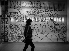 Ignore the Graffiti (Alfredo Esing) Tags: cbd bourkest melbourne omdem5ii blackandwhite olympus silhuette shadow walk yrban street noir night lifenightime nightlife city graffiti