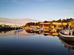 Sunrise over Porthmadoc Harbour, Gwynedd, North Wales (uk_dreamer) Tags: sunrise sunlight sun sunshine water sea reflection reflections reflected harbour harbor boats marine sailing wales cymru gwynedd morning dawn smooth mirror