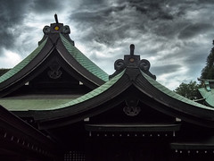 Hikawa Shrine under Stormy Clouds (Eshke04) Tags: shrine shintoist religious sacred hikawa saitama japan roof architecture old traditional complex clouds storm sky light reflection shadow historical lines curves