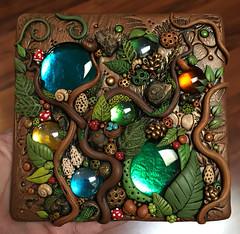 Woodland Tile Found Object Mosaic (MandarinMoon) Tags: polymerclay polymerclaytile foundobjectart mosaictile woodland forest mushrooms birdeggs nest vines leaves