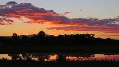 Autumn Skies (Patricia Henschen) Tags: sunset clouds trees reflection pond shadows color alamosa colorado town sanluisvalley rural wetland field mountain mountains sanjuan roadside