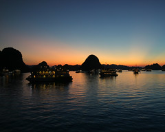 Sunset over Ha Long Bay (Kieran Culleton) Tags: canon eos m m3 vietnam ha long bay sunset orange water sea boat ship rock rocks islands island lights magic hour blue night reflections